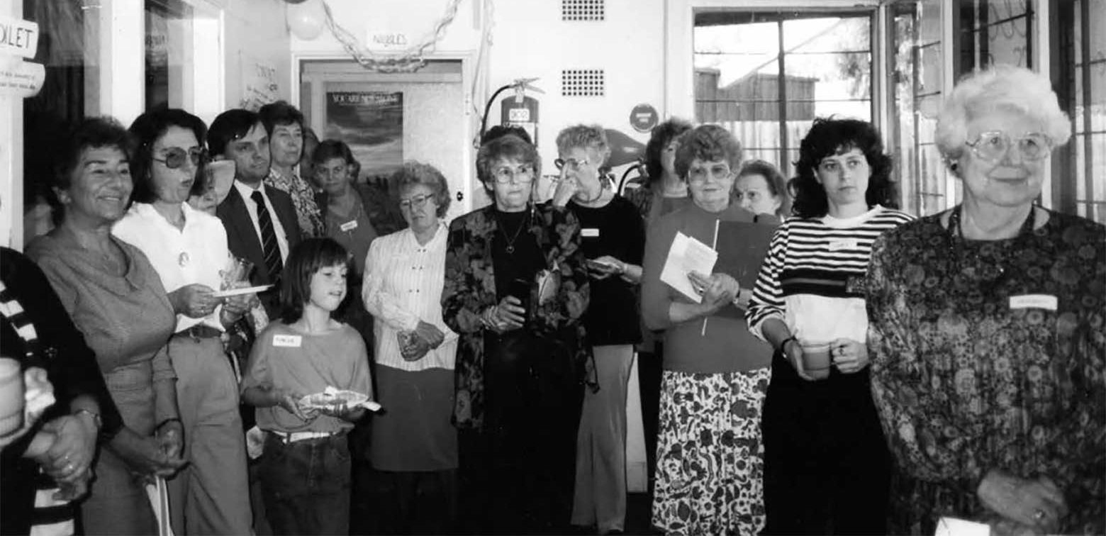 1991 - A group of women, standing at the OWN office opening