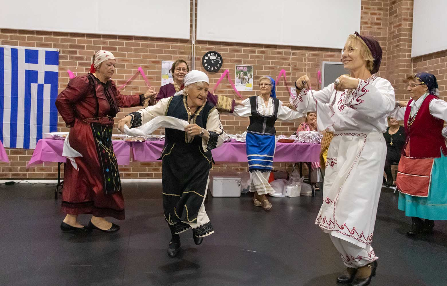 1994 - Women, in traditional Greek costume, dancing at a Bankstown Greek Group event