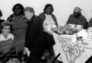 1995 - A group of women sitting around a table of food at the Aboriginal Study Circle