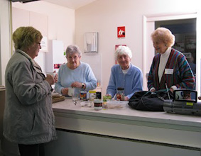 Elderly vistors at the the welcome desk at Northside Wellness Centre