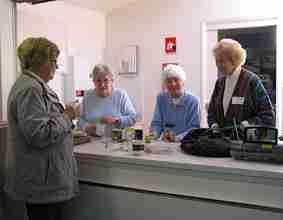 Elderly vistors at the the welcome desk at Northside Wellness Centre