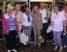 A group of 6 older women standing, posing for the camera