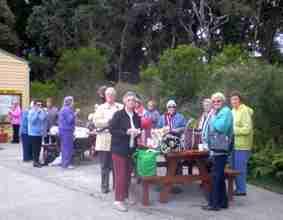 A group of older women enjoying a picnic