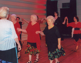 A group of older women dancing