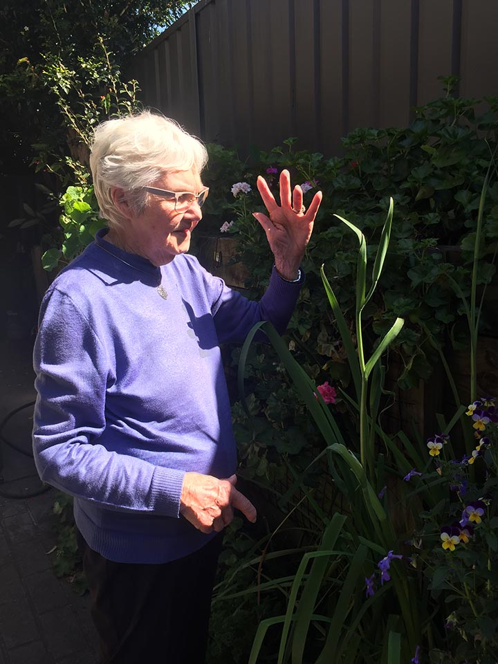 Barbara working in her garden
