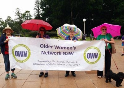 International Women's Day Rally, Rain or Shine, We'll be There
