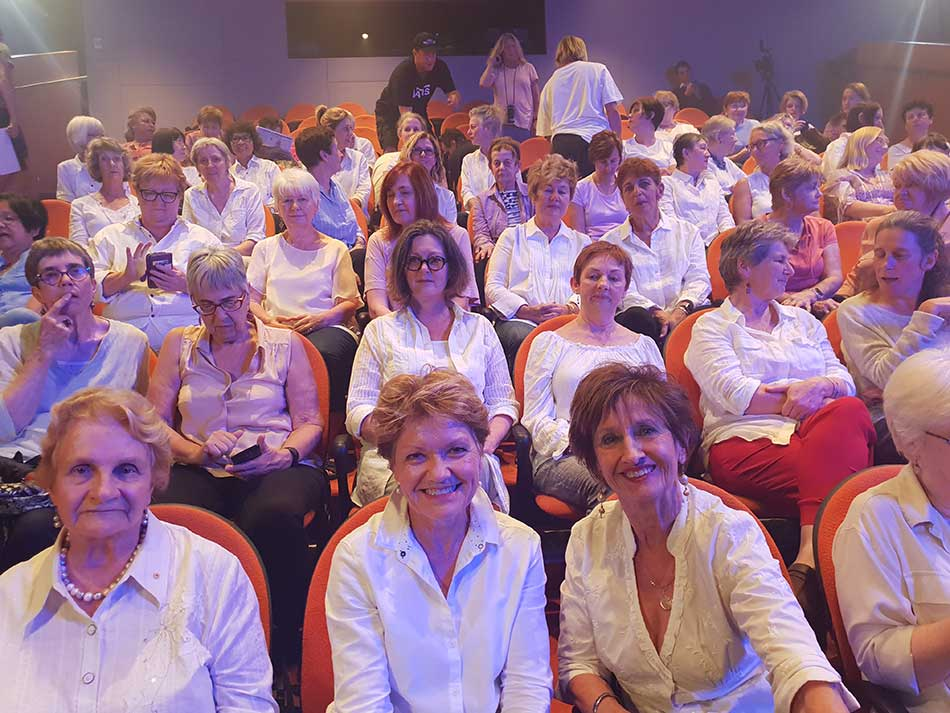 OWN participants sitting in theatre chairs