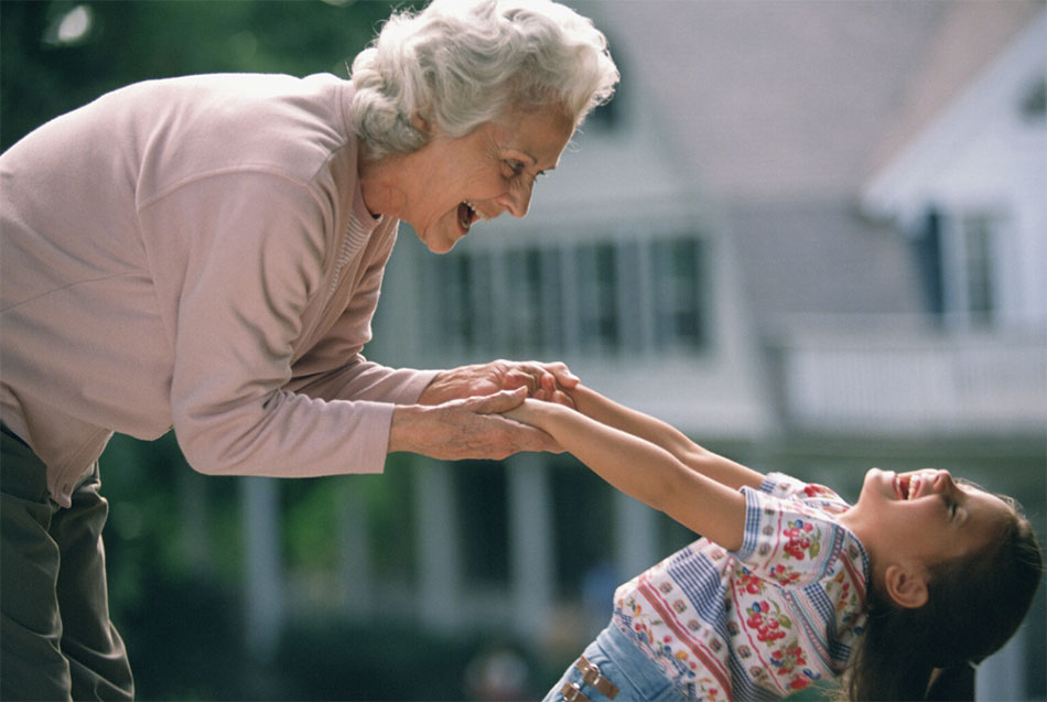 A grandmother playing with her granddaughter