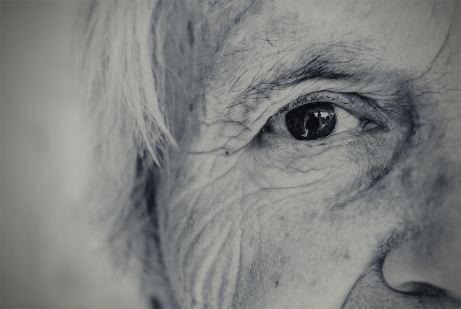 A close up of an elderly woman's face, mainly one eye