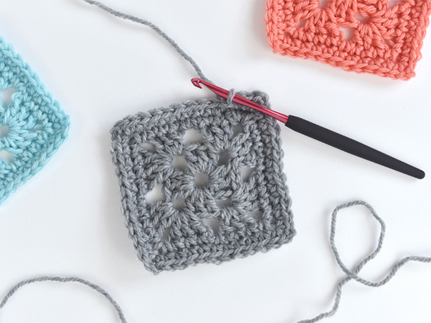 3 squares of knitted crochet and a hook