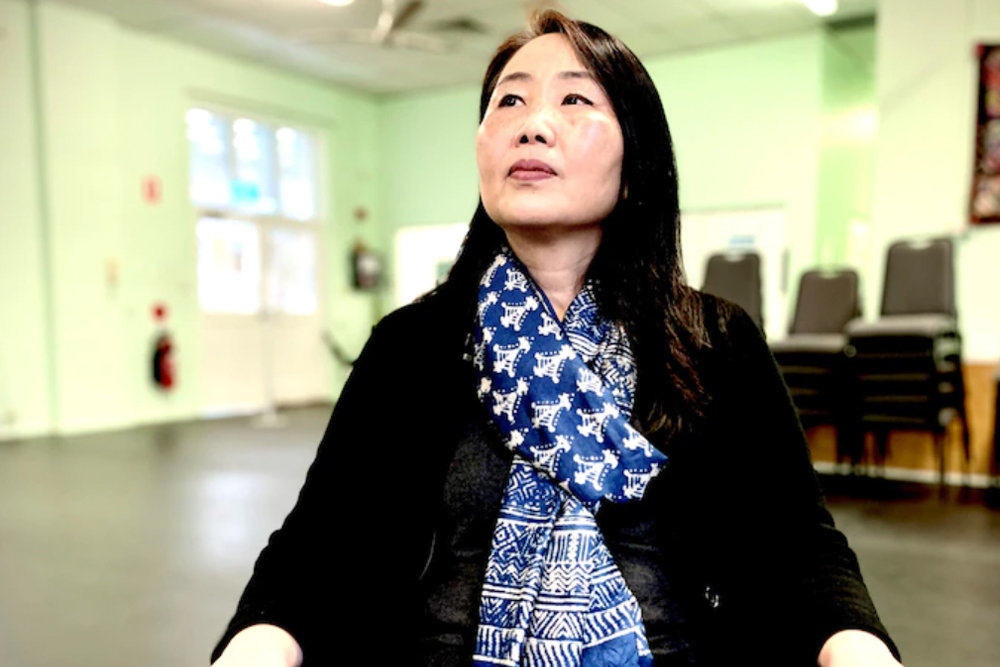 Yumi Lee sitting in the OWN office